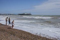 Brighton, England, the UK - people havin fun on the beach. stock image