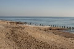 Eastbourne, England - beach and a blue sea. This image shows a view of a beach in Eastbourne, England, the UK. Eastbourne is a resort town on England's royalty free stock photos