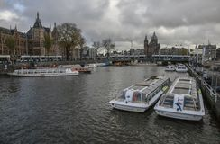 Amsterdam - a gloomy day in autumn. This image shows a view of a canal in Amsterdam. It was taken on a gloomy day in November 2017. We can see one of the canals stock photo