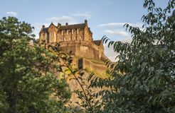 Streetsin Edinburgh - the castle at sunset. This image shows a view the castle in Edinburgh. It was taken at sunset on a sunny day in August 2018 stock photos