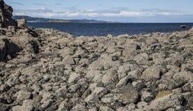 Cramond Island, Edinburgh, Scotland - the rocks on the island. This image shows a view Cramond Island, Edinburgh, Scotland. It was taken on a sunny day in royalty free stock images