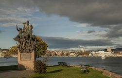 Oslo - fjord and a statue on the shore. This image shows a view of Oslo - the fjord with a closeup of a statue on the shore Stock Photo