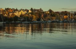 Oslo - the fjord - boats and houses. This image shows a view of Oslo - the fjord and some houses on the shore at sunset Royalty Free Stock Photography