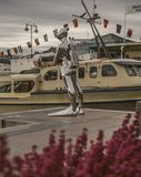 Oslo-fjord, a statue of a diver and the boats. This image shows a view of the Oslo-fjord at sunset. There`s a statue of a diver in the middle of it Royalty Free Stock Photo