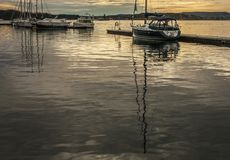 Oslo-fjord, golden waters of the fjord and some boats. Stock Photos