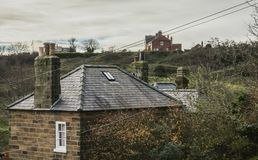 Robin Hood`s Bay - houses and roofs. The image shows a view of Robin Hood`s Bay - a village in Yorkshire. We can see some stone houses of the village stock image