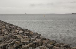 Copenhagen, Denmark - a sea view. This image shows a view of a sea in Copenhagen, Denmark. It was taken on a cloudy day in November. There`s the Oresund Bridge Royalty Free Stock Photo