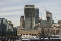 City of London, modern glass buildings and some boats. This image shows a view of some of the modern glass buildings in the City of London. It was taken in the Stock Photos