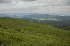 A view of Bieszczady Mountains, south Poland, eastern Europe - nature and danger. This image shows a view of some mountains, green meadows full of blueberry royalty free stock images