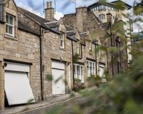 Streetsin Edinburgh - bushes and houses. This image shows a view some trees and a houses in Edinburgh. It was taken on a sunny day in summer 2018 stock photos