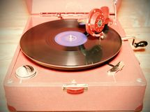 Image shows vintage gramophone famous Czech brand Supraphone. The red wind-up gramophone and vinyl record brand Ultraphon.  Ret Royalty Free Stock Photos
