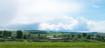The image of the Siberian village before a rain Royalty Free Stock Images