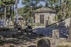 Image of a sidewalk with various graves on the sides in Belen Cemetery. On a sunny day in Guadalajara, Jalisco Mexico royalty free stock image