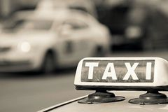 Image sign a taxi of beige color Royalty Free Stock Images
