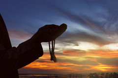 Image of silhouette man hand praying Royalty Free Stock Images