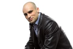 Image sitting hairless man in leather jacket Stock Photography