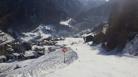 Image of ski run down in the valley stock photo