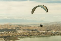 Lake Elsinore, California / United States - March 18, 2018: Lake Elsinore is the inland empire mecca for thrill seeking sports li. Image of a sky diver over Lake royalty free stock photography
