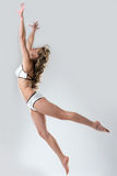 Image of slender model posing in jump Royalty Free Stock Photos