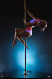 Image of slender young girl dancing on pole Royalty Free Stock Photos