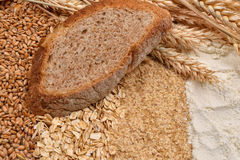 Image of a slice of bread with fresh ears wheat, dry beans of wh Royalty Free Stock Images