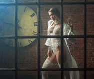 Image of the slim woman in a window Royalty Free Stock Images