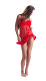 Image of slim young brunette in red negligee Royalty Free Stock Photo