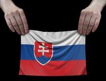 Slovak flag in hands. Image of Slovak flag in hands stock images