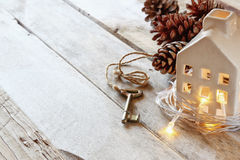 Image of small miniature house and old key over rustic wooden table Royalty Free Stock Photos