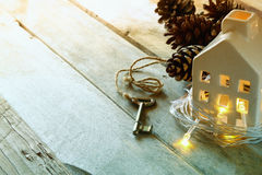 Image of small miniature house and old key over rustic wooden table. filtered and toned Stock Images