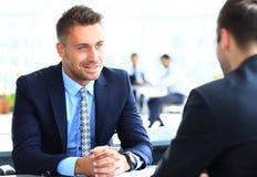 Image of smart businessman explaining Stock Photography