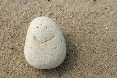 Image of smile on sea stone Stock Photography