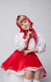 Image of smiling blonde girl in folk costume Stock Photography