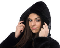 Image smiling brunette in fake fur coat with hood Royalty Free Stock Images