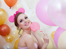 Image of smiling comely girl posing with lollipop Royalty Free Stock Photo