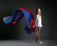Image of smiling girl posing with colorful cloth Royalty Free Stock Photo
