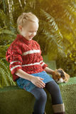 Image of smiling girl posing with cute cavy. Close-up Stock Images