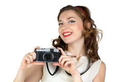 Image of the smiling woman with camera Stock Image
