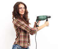 Image of smiling woman with drill over white wall Royalty Free Stock Photos