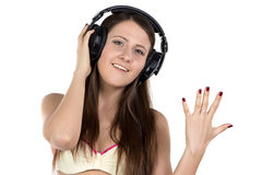 Image of smiling woman in headphones. On white background Royalty Free Stock Images