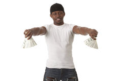 Image of  smiling young man. With dollars Royalty Free Stock Photography