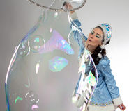 Image of snow maiden with long soap bubble Stock Photo