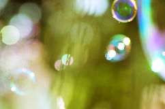 Image of soap bubbles over the green background Royalty Free Stock Photo