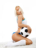 Image of soccer fan. Cute sexy player posing with ball Royalty Free Stock Photos