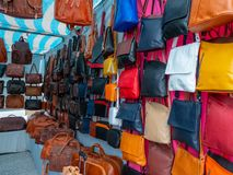 Bags of various colours and types in a flea market. Image of some bags of various colours and types in a flea market royalty free stock image
