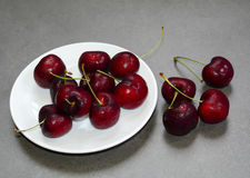 Fresh cherry fruits on the stone floor Royalty Free Stock Image