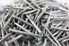 An Image of some steel nails - construction equipment. Tool - abstract Stock Photos