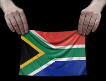 South African republic flag in hands stock photos
