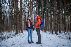 Image of sports man and woman standing in winter forest royalty free stock images