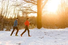 Image of sportswoman and sportsman on morning jog Stock Photo